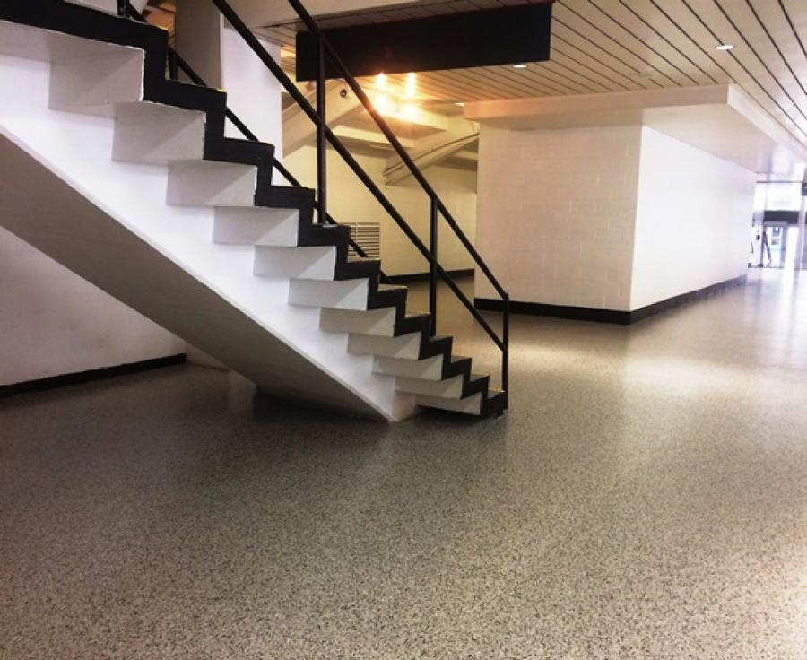 Double broadcast decorative vinyl flake epoxy floor systems add beauty to a facility, are easy to maintain and offer a long life span.
