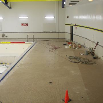 Glaze finish removed from existing tile using Blastrac System.