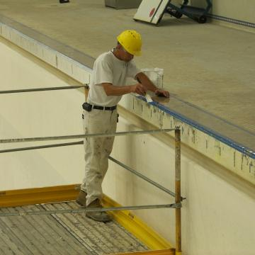 Pool coping hand brushed.