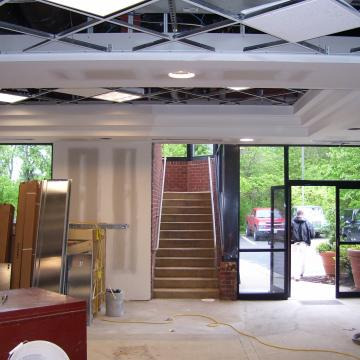 Renovation to enclose existing stairwell add elevator