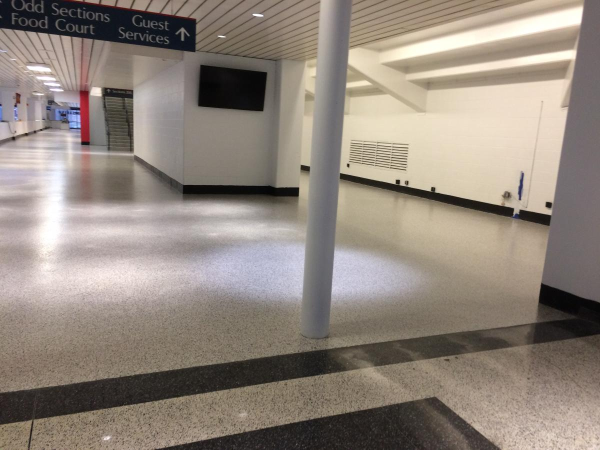 Decorative vinyl flake epoxy flooring is an excellent choice to match existing terrazzo surfaces.