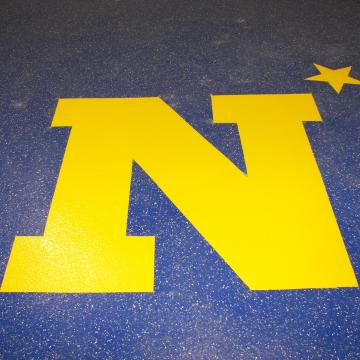 The United States Naval Academy Logo integrated within an epoxy floor.