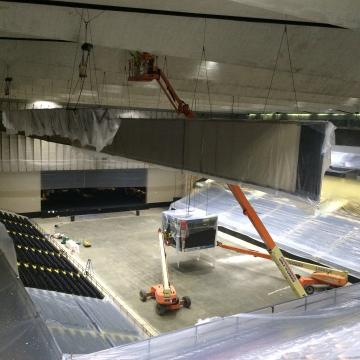 Masking all surfaces prior to coating the ceiling of Royal Farms Arena