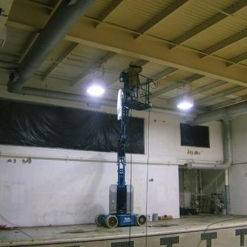 Prior to coating the failing ceiling & wall surfaces, fixtures not receiving coatings are masked.