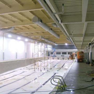 To stage the project, lifts and scaffolding are put in place.