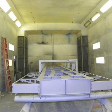 Priming Structural Steel in Paint Booth.